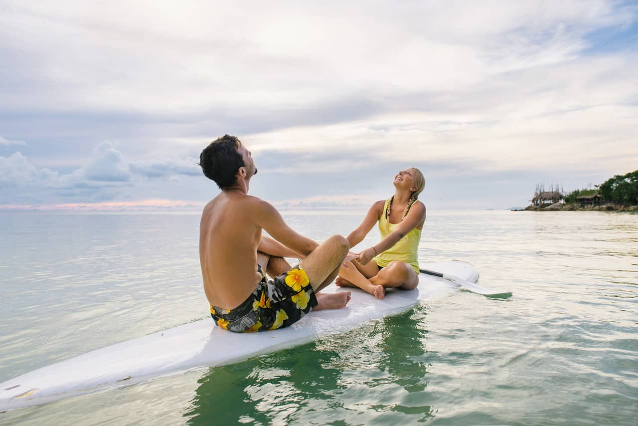 A couple enjoying SUP together