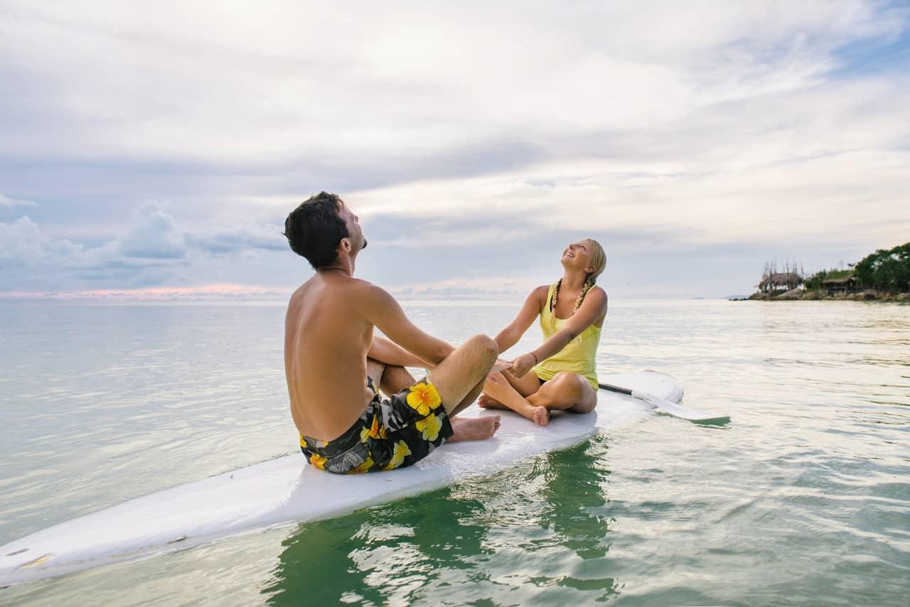 A couple enjoying SUP together
